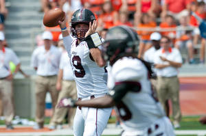 Photo - Southern Illinois quarterback Kory Faulkner (19) throws a pass to running back Tay Willis (18) during the second quarter against the Illinois in an NCAA college football game at Memorial Stadium in Champaign, Ill., on Saturday, Aug. 31, 2013. (AP Photo/The News-Gazette, Bradley Leeb) MANDATORY CREDIT