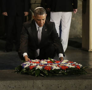 Photo - U.S. President Barack Obama lays a wreath during his visit to the Hall of Remembrance at the Yad Vashem Holocaust Memorial in Jerusalem, Israel, Friday, March 22, 2013. (AP Photo/Pablo Martinez Monsivais)
