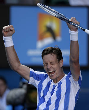 Photo - Tomas Berdych of the Czech Republic celebrates after defeating David Ferrer of Spain during their quarterfinal at the Australian Open tennis championship in Melbourne, Australia, Tuesday, Jan. 21, 2014.(AP Photo/Rick Rycroft)