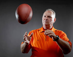 Photo - Oklahoma State defensive coordinator Bill Young's job gets tougher starting this week as the Cowboys start a stretch of games against the top offenses in the Big 12. Photo by Bryan Terry, The Oklahoman. <strong>BRYAN TERRY</strong>