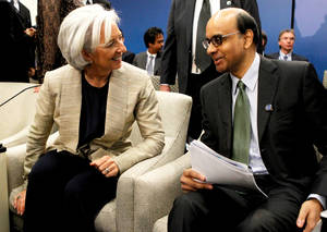 Photo - International Monetary Fund (IMF) Managing Director Christine Lagarde, left, talks with IMFC Chair Tharman Shanmugaratnam during the World Bank IMF Spring Meetings in Washington, Saturday, April 20, 2013. (AP Photo/Molly Riley)