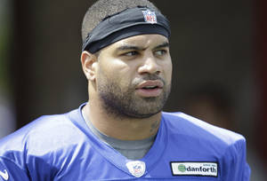 Photo -   FILE - Athis July 26, 2012 file photo shows Buffalo Bills' Shawne Merriman during NFL football training camp in Pittsford, N.Y. It's lights out for Merriman in Buffalo after the Bills cut the one-time star pass-rusher. The move was announced by the team in a one-sentence news release issued late Monday morning, Aug. 20, 2012, as the Bills prepared to return to practice following a two-day break. (AP Photo/David Duprey, File)