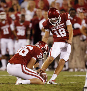 Photo - Oklahoma Sooners's Michael Hunnicutt (18) kicks a field goal during a college football game between the University of Oklahoma Sooners (OU) and the Kansas State University Wildcats (KSU) at Gaylord Family-Oklahoma Memorial Stadium, Saturday, September 22, 2012. Photo by Steve Sisney, The Oklahoman