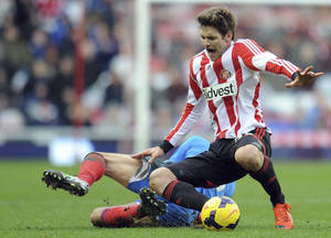 Photo - Hull's Robert Koran and Sunderland's Marcus Alonso, compete for the ball during the English Premier League soccer match between Sunderland and Hull City at the Stadium of Light, Sunderland, England, Saturday, Feb. 8, 2014. (AP Photo/Owen Humphreys, PA Wire)   UNITED KINGDOM OUT   -  NO SALES  -  NO ARCHIVES