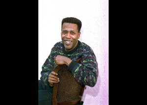 "Photo - FILE - In this Jan. 30, 1989 file photo, actor Meshach Taylor poses during an interview in Los Angeles, Calif. Taylor's agent says the actor, who appeared in the hit sitcoms ""Designing Women"" and ""Dave's World"" died of cancer on Saturday, June 28, 2014, at his home in Los Angeles. He was 67.  (AP Photo/Nick Ut, File)"