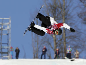 Photo - Canada's Mark McMorris takes a jump during the men's  snowboard slopestyle semifinal at the Rosa Khutor Extreme Park, at the 2014 Winter Olympics, Saturday, Feb. 8, 2014, in Krasnaya Polyana, Russia. (AP Photo/Andy Wong)