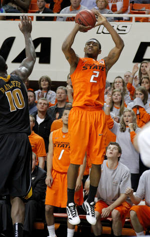 Photo - Oklahoma State's Le'Bryan Nash (2) shoots a basket as the crowd watches during an NCAA college basketball game between the Oklahoma State University Cowboys (OSU) and the Missouri Tigers (MU) at Gallagher-Iba Arena in Stillwater, Okla., Wednesday, Jan. 25, 2012. Photo by Bryan Terry, The Oklahoman