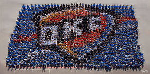 Photo - Right: Students and staff at Edmond's Cross Timbers Elementary School create a human formation of the Oklahoma City Thunder logo.  Photo provided by Edmond Public Schools