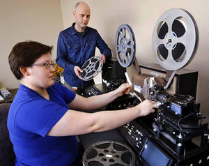 OKLAHOMA HISTORY CENTER: Diane Wasser, film and video archivist, and Cory Ayers, moving image archivist in the research division at the Oklahoma Historical Society, at the controls of a high definition film conversion unit  on Tuesday, Jan. 15, 2013. They are converting films of a 1960s era Central High School vs. Enid football game into high definition digital images.  Corey Ayers is the Moving Image Archivist for the Oklahoma Historical Society. In the past year, he and Wasser have processed and cleaned up more than 320 historic films, converting them into high-def and uploading smaller versions to YouTube.   Photo by Jim Beckel, The Oklahoman
