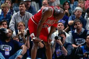 Photo - Michael Jordan regrets ordering pepperoni during the Flu Game (Dick Raphael/ Getty).