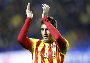 Photo - Barcelona's  Lionel Messi from Argentina claps his hands  during their la Copa del Rey soccer match against Levante at the Ciutat de Valencia stadium in Valencia, Spain, Wednesday Jan. 22, 2014. The Argentinean plays his 400th game in an Barcelona shirt in the Copa del Rey against Levante.(AP Photo/Alberto Saiz)