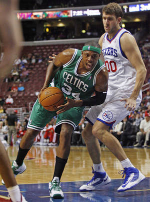 Photo -   Boston Celtics' Paul Pierce (34) drives against Philadelphia 76ers' Spencer Hawes (00) in the first half of an NBA preseason basketball game, Monday Oct. 15, 2012, in Philadelphia. (AP Photo/H. Rumph Jr)