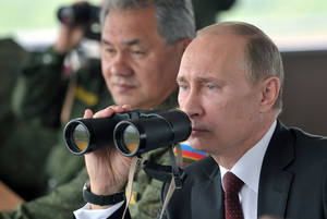 Photo - FILE - In this Tuesday, July 16, 2013 file photo Russian President Vladimir Putin, flanked by Defense Minister Sergei Shoigu, uses binocular as he watches military exercise near Yuzhno-Sakhalinsk, on Sakhalin Island, Russia. President Vladimir Putin on Wednesday, Feb. 26, 2014, ordered massive exercises involving most of its military units in western Russia amid tensions in Ukraine.  (AP Photo/RIA Novosti, Alexei Nikolsky, Presidential Press Service, Pool)