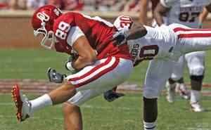 Photo - Austin Haywood (89) holds on to a pass defended by Javon Harris (30) during the University of Oklahoma Sooner's (OU) Spring Football game at Gaylord Family-Oklahoma Memorial Stadium on Saturday, April 16, 2011, in Norman, Okla.  