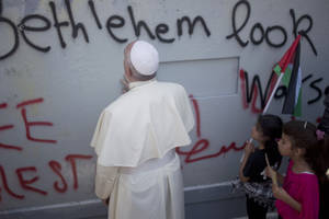 "Photo - Pope Francis prays at Israel's separation barrier on his way to a mass in Manger Square next to the Church of the Nativity, traditionally believed to be the birthplace of Jesus Christ in the West Bank city of Bethlehem on Sunday, May 25, 2014. Francis called the Israeli-Palestinian stalemate ""unacceptable"" as he landed Sunday in the West Bank town of Bethlehem in a symbolic nod to Palestinian aspirations for their own state. (AP Photo/Ariel Schalit)"