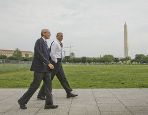Photo - President Barack Obama and White House counselor John Podesta, left, walk across the ellipse in Washington as they head towards the Dept. of Interior, Wednesday, May 21, 2014. Obama and Podesta also walked back to the White House after a signing a proclamation regarding the Organ Mountains-Desert Peaks National Monument. (AP Photo/Pablo Martinez Monsivais)