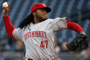 Photo - Cincinnati Reds starting pitcher Johnny Cueto delivers during the first inning of a baseball game against the Pittsburgh Pirates in Pittsburgh Tuesday, April 22, 2014. (AP Photo/Gene J. Puskar)