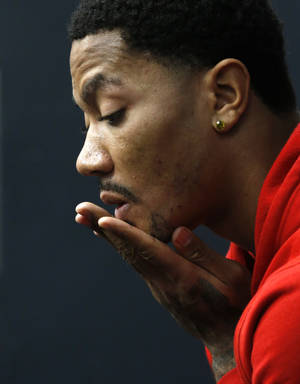 Photo - Chicago Bulls' Derrick Rose ponders a question during an NBA basketball news conference about his injured knee at the United Center Thursday, Dec. 5, 2013, in Chicago. (AP Photo/Charles Rex Arbogast)
