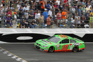 Photo - Danica Patrick competes during NASCAR Daytona 500 Sprint Cup Series auto race at Daytona International Speedway, Sunday, Feb. 24, 2013, in Daytona Beach, Fla. (AP Photo/Terry Renna)