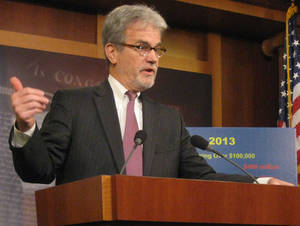Photo - Sen. Tom Coburn, R-Muskogee, speaks during a Capitol Hill press conference on Tuesday about wasteful government spending. <strong>Chris Casteel - The Oklahoman</strong>