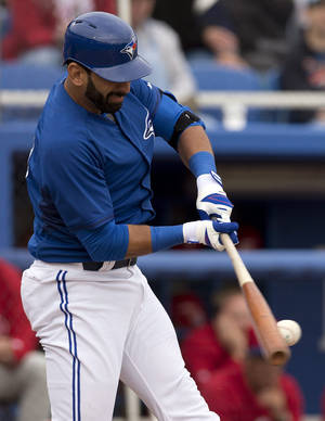 Photo - Toronto Blue Jays' Jose Bautista hits a double against the Philadelphia Phillies in the first inning of an exhibition baseball game in Dunedin, Fla.,  Thursday Feb. 27, 2014. (AP Photo/The Canadian Press, Frank Gunn)
