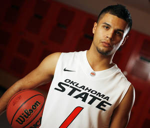 Photo - COLLEGE BASKETBALL: OSU men's basketball player Cezar Guerrero (1) poses for a portrait at Oklahoma State University in Stillwater, Okla., Thursday, Oct. 27, 2011.  Photo by Nate Billings, The Oklahoman