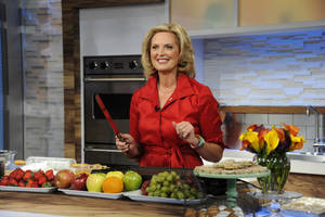 "Photo -   This image released by ABC shows Ann Romney, wife of Republican presidential hopeful Mitt Romney during a cooking segment on ""Good Morning America,"" Wednesday, Oct. 10, 2012 in New York. Romney served as a guest co-host on the popular morning show. (AP Photo/ABC, Ida Mae Astute)"