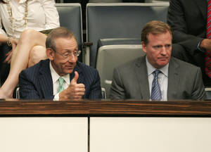 Photo - Stephen Ross, left, owner of the Miami Dolphins and NFL commissioner Roger Goodell watch from the gallery as a bill for funding stadium renovations is debated during session on Monday, April 29, 2013, in Tallahassee, Fla. (AP Photo/Steve Cannon)