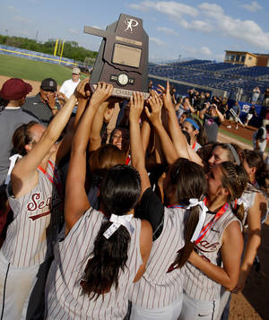 photo - HIGH SCHOOL SOFTBALL / CELEBRATION: The Sequoyah-Tahlequah team celebrates with the trophy after winning the Class 5A slowpitch softball state tournament championship game between Morris and Sequoyah-Tahlequah at ASA Hall of Fame Stadium in Oklahoma City, Tuesday, May 1, 2012. Photo by Bryan Terry, The Oklahoman