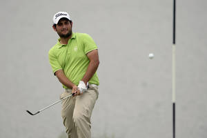 Photo - In this photo released by OneAsia, Alexander Levy of France watches his shot during the final round of the Volvo China Open at Genzon Golf Club in Shenzhen, southern China, Sunday, April 27, 2014. Levy held on to win his maiden European Tour title at the China Open on Sunday, recovering from a late double bogey to shoot a 69 and beat Tommy Fleetwood by four strokes. (AP Photo/OneAsia, Paul Lakatos) NO LICENSING