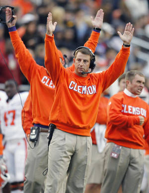 photo -   Clemson head coach Dabo Swinney, center, reacts after the play review of a Clemson touchdown was upheld in the second quarter of an NCAA college football game against Boston College in Boston, Saturday, Sept. 29, 2012. (AP Photo/Michael Dwyer)