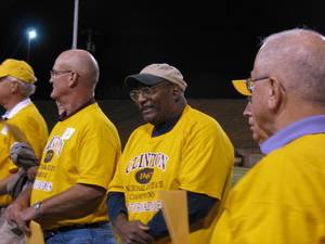 Photo - Former University of Oklahoma great Roy Bell, center, and the rest of the 1967 state championship high school football team from Clinton is recognized Friday night at halftime of the Clinton-Elk City football game at the Tornado Bowl. Photo by Ed Godfrey, The Oklahoman