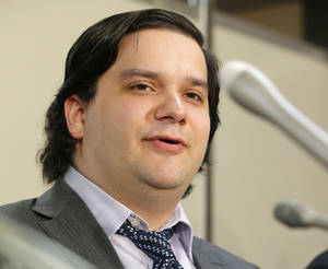 Photo - Mt. Gox CEO Mark Karpeles speaks at a news conference at the Justice Ministry in Tokyo, Friday night, Feb. 28, 2014. The Mt. Gox bitcoin exchange in Tokyo filed for bankruptcy protection, acknowledging that a significant amount of the virtual currency had gone missing. Karpeles appeared before Japanese TV news cameras Friday, bowing deeply for several minutes. He said a weakness in the exchange's systems was behind the massive loss of the virtual currency. (AP Photo/Kyodo News) JAPAN OUT, MANDATORY CREDIT