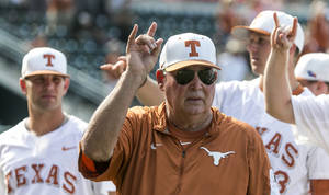 <p>In this Saturday, May 21, 2016, file photo, Texas coach Augie Garrido sings The Eyes of Texas with the team after Texas defeated Baylor 7-6 in an NCAA college baseball game in Austin, Texas. Garrido, the winningest coach in college baseball history, is out after 20 seasons at Texas. The decision Monday, May 30, 2016, comes after the Longhorns' first losing season since 1998. . (Rodolfo Gonzalez/Austin American-Statesman via AP)</p>