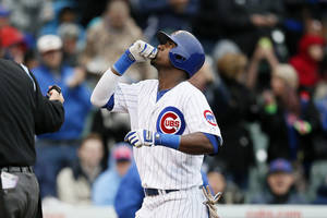 Photo - Chicago Cubs' Junior Lake celebrates after hitting a solo home run against the Milwaukee Brewers during the third inning of a baseball game on Friday, May 16, 2014, in Chicago. (AP Photo/Andrew A. Nelles)