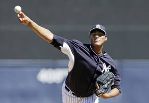 Photo - New York Yankees starting pitcher Ivan Nova throws during the first inning of an exhibition baseball game against the Washington Nationals, Monday, March 3, 2014, in Tampa, Fla. (AP Photo/Charlie Neibergall)