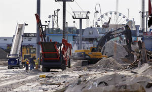 photo - Crews work work to replace the Superstorm Sandy destroyed boardwalk in Seaside Heights, N.J., Thursday, Jan. 3, 2013.   Under intense pressure from angry Republicans, House Speaker John Boehner has agreed to a vote this week on aid for Superstorm Sandy recovery.  (AP Photo/Mel Evans)