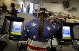 "Photo -   Victor ""Snake Mann"" Wolder, marks his choices while voting during Election Day, Tuesday, Nov. 6, 2012, in Las Vegas. (AP Photo/Julie Jacobson)"