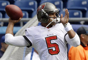 Photo - Tampa Bay Buccaneers quarterback Josh Freeman warms up before an NFL football game against the New England Patriots Sunday, Sept. 22, 2013, in Foxborough, Mass. (AP Photo/Stephan Savoia)