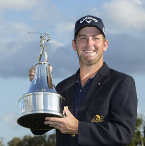 Photo - Matt Every holds the trophy after winning the Arnold Palmer Invitational golf tournament at Bay Hill, Sunday, March 23, 2014, in Orlando, Fla. (AP Photo/Willie J. Allen Jr.)