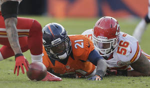 photo - Denver Broncos running back Ronnie Hillman (21) fumbles the ball as he is tackled by Kansas City Chiefs inside linebacker Derrick Johnson (56) in the first quarter of an NFL football game, Sunday, Dec. 30, 2012, in Denver. Kansas City recovered the ball on the play.  (AP Photo/Joe Mahoney)