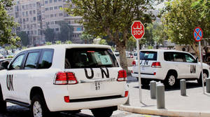 Photo - UN vehicles leave the Four Season Hotel in Damascus, Syria, Thursday, Aug. 29, 2013. U.N. experts investigating purported poison gas attacks left their Damascus hotel Thursday, but anti-regime activists said the team's destination was not immediately known. (AP Photo)