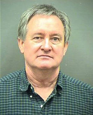 Photo - This Sunday, Dec. 23, 2012 booking photo provided by the Alexandria, Va. Police Department shows Idaho U.S. Sen. Michael Crapo. Crapo was arrested early Sunday morning, Dec. 23, 2012 and charged with driving under the influence in a Washington, D.C., suburb, authorities said. (AP Photo/Alexandria Police Department)