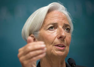 Photo -  International Monetary Fund Managing Director Christine Lagarde gestures while speaking during a news conference, Monday at IMF headquarters in Washington. The IMF foresees the U.S. economy growing a modest 2 percent this year, below its previous estimate of 2.7 percent. AP Photo  <strong>Pablo Martinez Monsivais -  AP </strong>