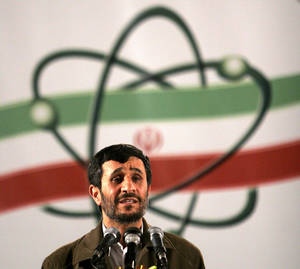 Photo -   FILE- In this April, 9, 2007, file photo Iranian President Mahmoud Ahmadinejad, speaks at a ceremony in Iran's nuclear enrichment facility in Natanz, 300 kms 186 (miles) south of capital Tehran, Iran. Iran's denials that it is trying to develop nuclear weapons carry a distinctly hollow ring among its foes as the U.N. nuclear watchdog piles on worries: Complaining about limits on inspection access and reporting that Tehran is expanding its nuclear fuel labs. But, as Israel increasingly weighs the option of a military strike, Western leaders wary of another Middle East conflict may have to pay closer attention to the claims. (AP Photo/Hasan Sarbakhshian, File)