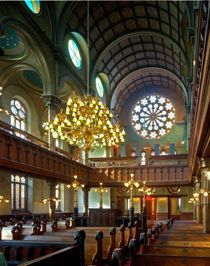 "Photo - This January 2008 provied by The New York Landmarks Conservancy shows the Eldridge Street Museum and Synagogue on the Lower East Side of New York. The 1887 building boasts a soaring 50-foot ceiling and lavish Moorish-style interior and will be featured in The New York Landmarks Conservancy ""Sacred Sites Open House Weekend"" on May 17 & 18. (AP Photo/The New York Landmarks Conservancy, courtesy of the Museum at Eldridge Street, Kate Milford)"