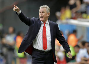 Photo - Switzerland's coach Ottmar Hitzfeld shouts from the touchline during the group E World Cup soccer match between Switzerland and Ecuador at the Estadio Nacional in Brasilia, Brazil, Sunday, June 15, 2014. (AP Photo/Michael Sohn)