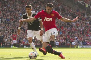 Photo - Manchester United's Robin van Persie, right, scores as Southampton's Jose Fonte looks on during their English Premier League soccer match at Old Trafford Stadium, Manchester, England, Saturday Oct. 19, 2013. (AP Photo/Jon Super)