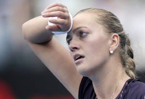 Photo - Petra Kvitova of the Czech Republic wipes her forehead while playing Tsvetana Pironkova of Bulgaria during their women's singles match at the Sydney International tennis tournament in Sydney, Thursday, Jan. 9, 2014.(AP Photo/Rick Rycroft)
