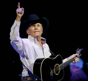 "Photo - George Strait performs during ""The Cowboy Rides Away Tour"" at Chesapeake Energy Arena in January. Photo by Bryan Terry, The Oklahoman Archive <strong>BRYAN TERRY - BRYAN TERRY</strong>"